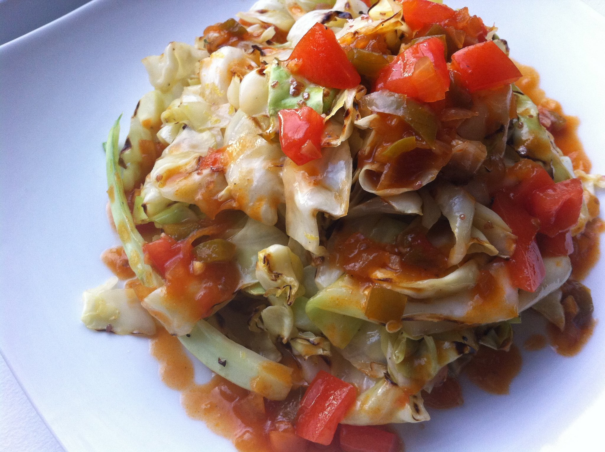 Grilled Cabbage with Dark Rum Lemon Drizzle and Tomato-Onion Relish